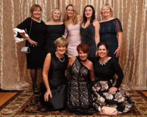 Pictured, from back row, starting from left: Denise Dionne, Nancy Warren, Donna Saal, Sarah Neadow, Karen Roosen Front Row, From Left: Lisa Edmonds, Marianne Minns, Laura Carroll Missing From Photo: Lynda Dobbs, Tatum Perham, Marcey Stefanski, and Karolyn Xie